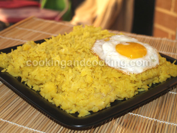 Dami e Baghali (turmeric rice and lima beans)